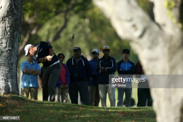 Lee Westwood of England hits his second shot on the 1st hole in the final round of the Northern Trust Open at the Riviera Country Club on February 16...