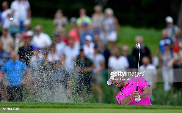 Lee Westwood of England hits out of the sand on the 9th hole during the second round on day two of the Nordea Masters at Bro Hof Slott Golf Club on...