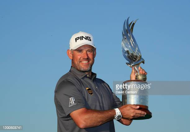 Lee Westwood of England holds the Falcon Trophy after his two shot victory during the final round of the Abu Dhabi HSBC Championship at Abu Dhabi...