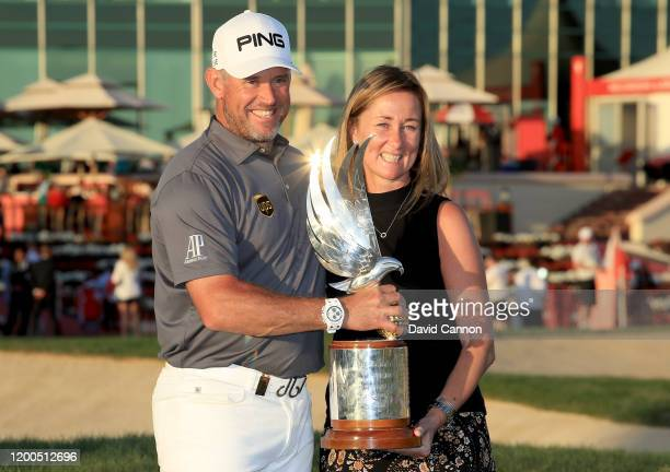Lee Westwood of England holds the Falcon Trophy with his business manager Angela Jones from IMG after his two shot victory during the final round of...