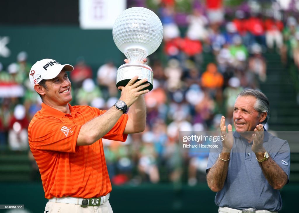 Lee Westwood of England holds the trophy aloft as tournament host Gary Player looks on after the final round of the Nedbank Golf Challenge at the Gary Player Country Club on December 4, 2011 in Sun City, South Africa.