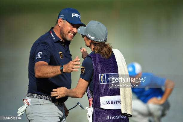 Lee Westwood of England hugs his caddie girlfriend Helen Storey on hole eighteen during Day Four of the Omega Dubai Desert Classic at Emirates Golf...
