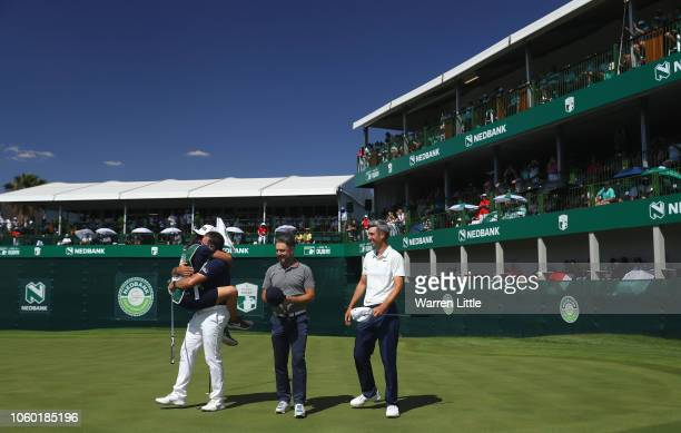 Lee Westwood of England is congratulated by partner and caddie Helen Storey after winning the Nedbank Golf Challenge at Gary Player CC on November 11...