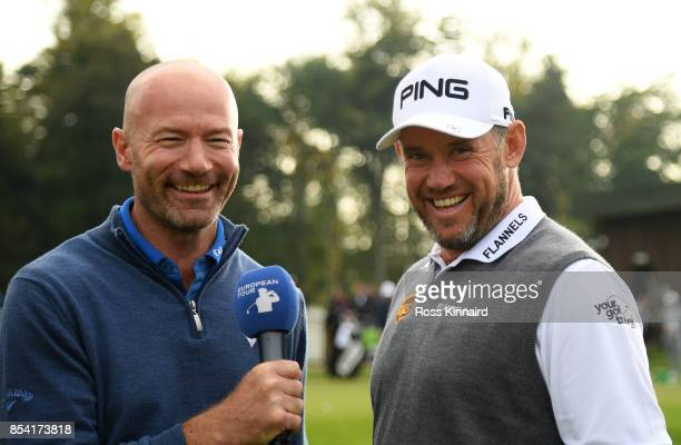 Lee Westwood of England is interviewed by former international footballer Alan Shearer during a practice round prior to the British Masters at Close...