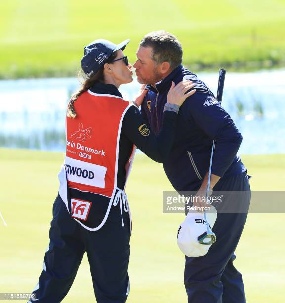 Lee Westwood of England is pictured with is girlfriend caddie Helen Storey on the 18th hole during Day Three of the Made in Denmark at Himmerland...
