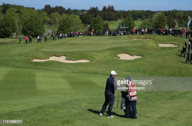 Lee Westwood of England is pictured with is girlfriend caddie Helen Storey on the 17th hole during Day Three of the Made in Denmark at Himmerland...