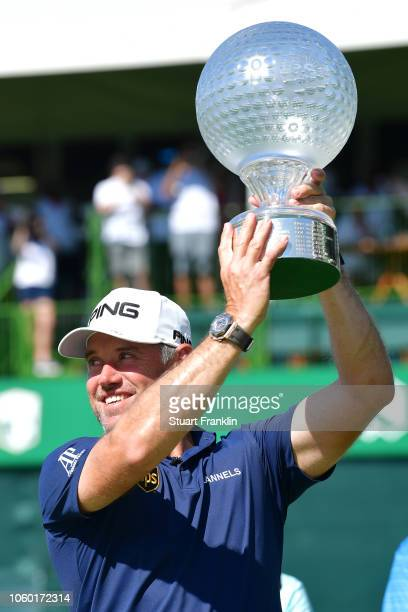 Lee Westwood of England is presented the trophy after he wins the Nedbank Golf Challenge at Gary Player CC on November 11 2018 in Sun City South...