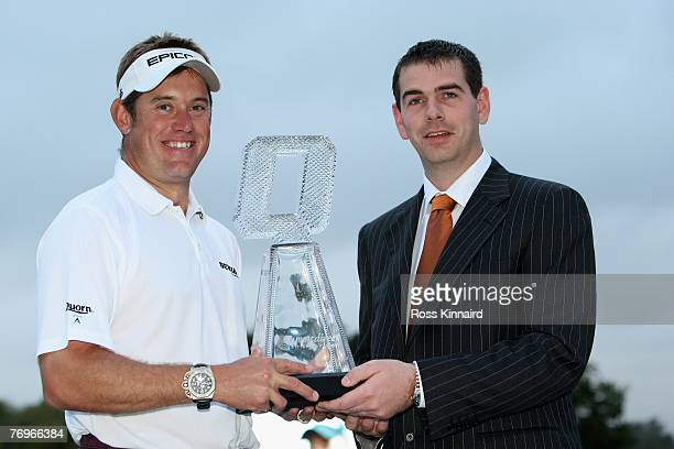 Lee Westwood of England is presented with the winners trophy by Sean Quinn Jr of the Quinn Group after the final round of the Quinn Direct British...