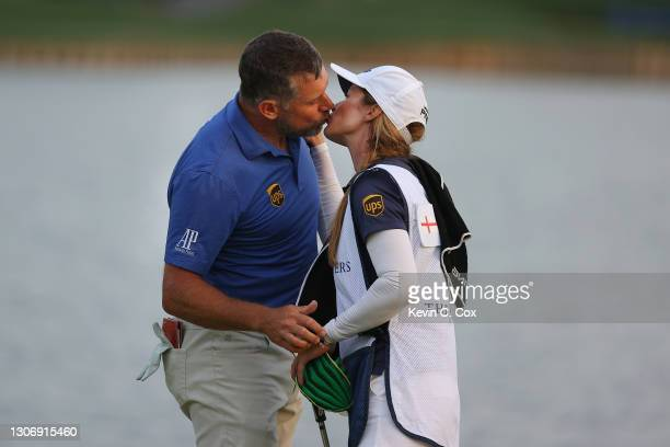 Lee Westwood of England kisses his caddie and partner Helen Storey after finishing on the 18th green during the third round of THE PLAYERS...