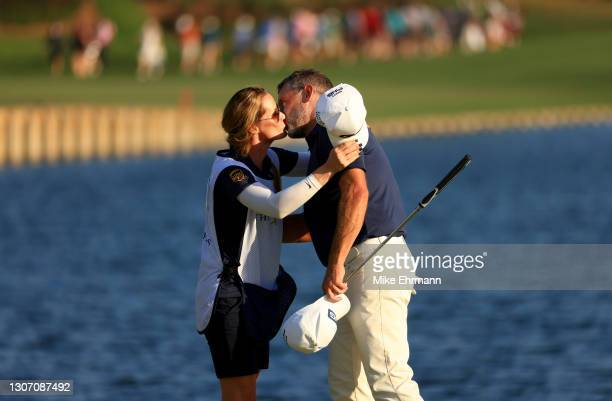 Lee Westwood of England kisses his caddie and partner Helen Storey after finishing on the 18th green during the final round of THE PLAYERS...