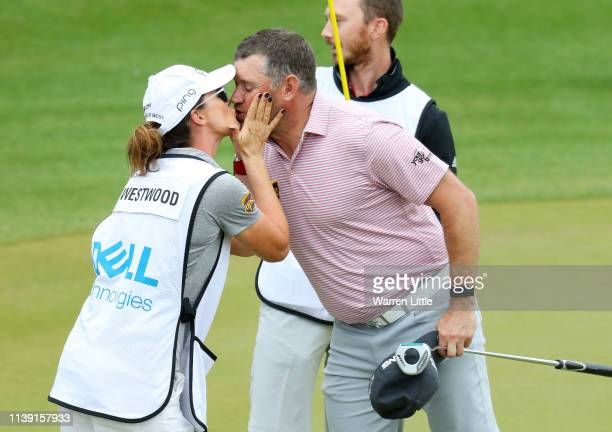 Lee Westwood of England kisses his girlfriend and caddie Helen Storey during the third round of the World Golf ChampionshipsDell Technologies Match...