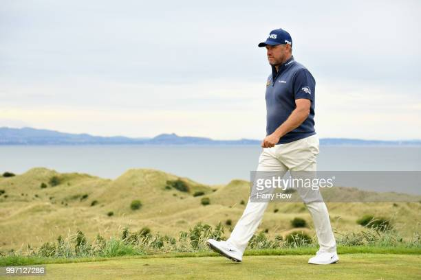 Lee Westwood of England leaves the tee on hole fifteen during day one of the Aberdeen Standard Investments Scottish Open at Gullane Golf Course on...