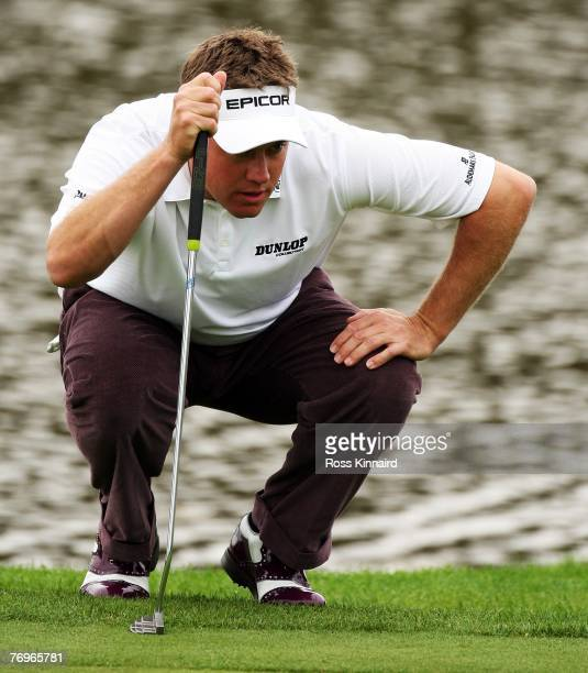 Lee Westwood of England lines up a putt during the final round of the Quinn Direct British Masters on the Brabazon Course at the Belfry September 23,...