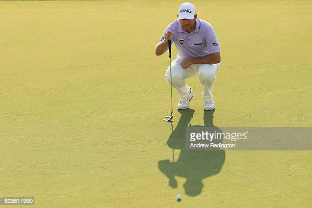 Lee Westwood of England lines up a putt on the 18th green during day one of the DP World Tour Championship at Jumeirah Golf Estates on November 17...