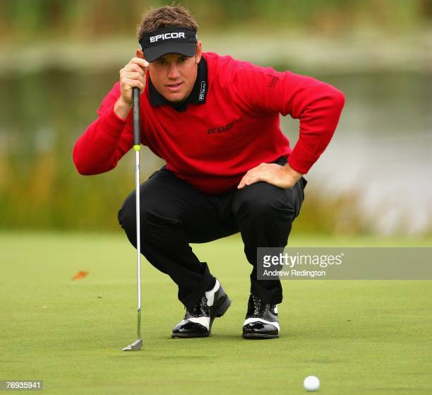 Lee Westwood of England lines up a putt on the 18th green during the second round of the Quinn Direct British Masters on the Brabazon Course at The...