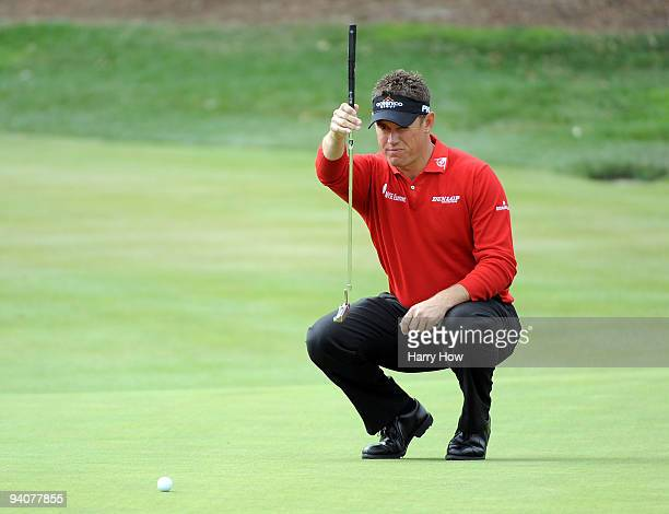 Lee Westwood of England lines up his putt on the third hole during the fourth round of the Chevron World Challenge at Sherwood Country Club on...