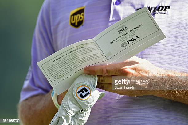 Lee Westwood of England looks at his scorecard on the 15th hole during the first round of the 2016 PGA Championship at Baltusrol Golf Club on July 28...