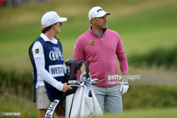 Lee Westwood of England looks on the 14th hole with his caddie Helen Storey during the second round of the 148th Open Championship held on the...