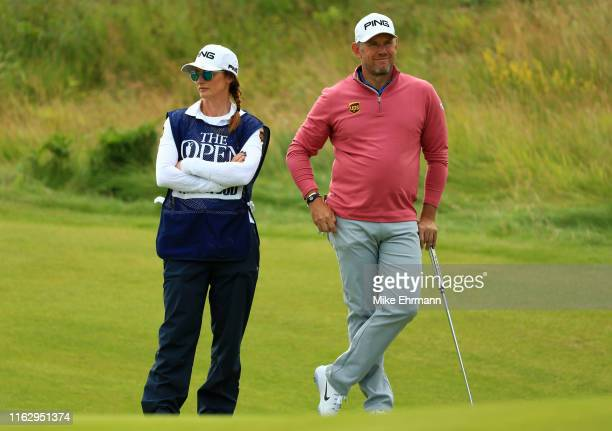 Lee Westwood of England looks on the 2nd green with his caddie Helen Storey during the second round of the 148th Open Championship held on the...
