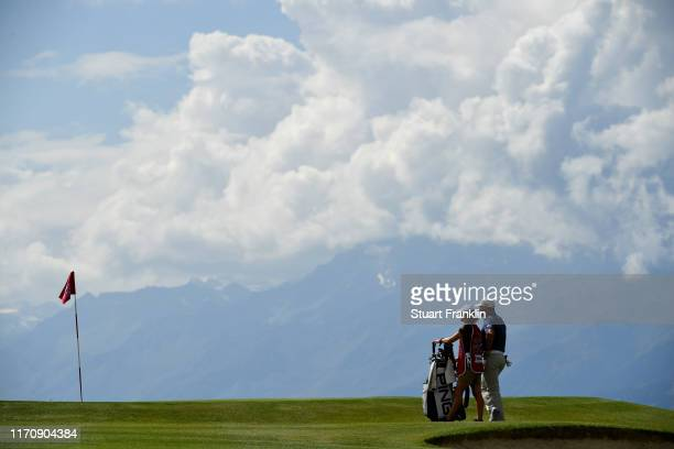 Lee Westwood of England looks on with his caddie Helen Storey on the seventh during Day One of the Omega European Masters at Crans Montana Golf Club...