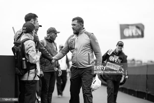 Lee Westwood of England meets his walking scorers as he walks to the first tee during the final round of the 148th Open Championship held on the...