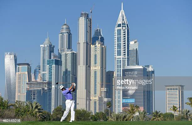 Lee Westwood of England on the par five 13th hole during the first round of the Omega Dubai Desert Classic at the Emirates Golf Club on January 29...