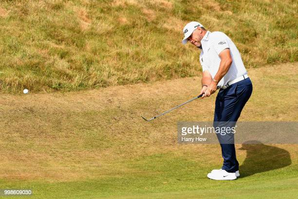 Lee Westwood of England plays a chip on hole one during day three of the Aberdeen Standard Investments Scottish Open at Gullane Golf Course on July...