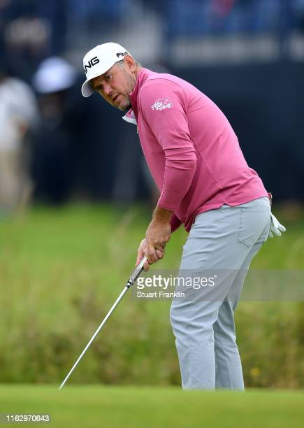 Lee Westwood of England plays a putt on the 14th green during the second round of the 148th Open Championship held on the Dunluce Links at Royal...