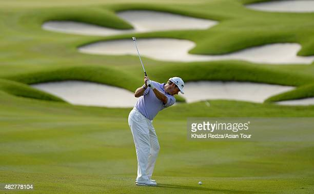 Lee Westwood of England plays a shot during round one of the Maybank Malaysian Open at Kuala Lumpur Golf Country Club on February 5 2015 in Kuala...
