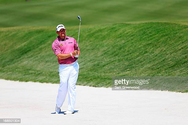Lee Westwood of England plays a shot from a bunker during round two of THE PLAYERS Championship at THE PLAYERS Stadium course at TPC Sawgrass on May...