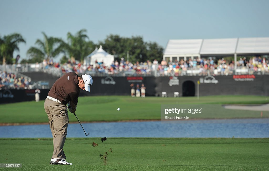 Lee Westwood of England plays a shot on the 16th hole during the first round of the Honda Classic on February 28, 2013 in Palm Beach Gardens, Florida.