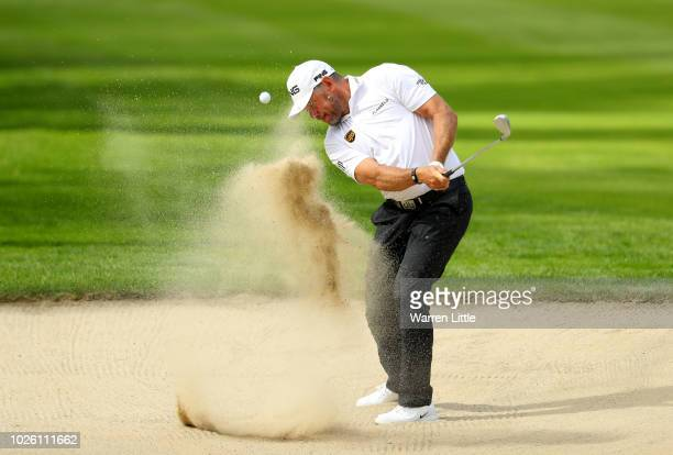 Lee Westwood of England plays from a bunker on the 6th hole during the final round on day four of the Made in Denmark played at the Silkeborg Ry GC...