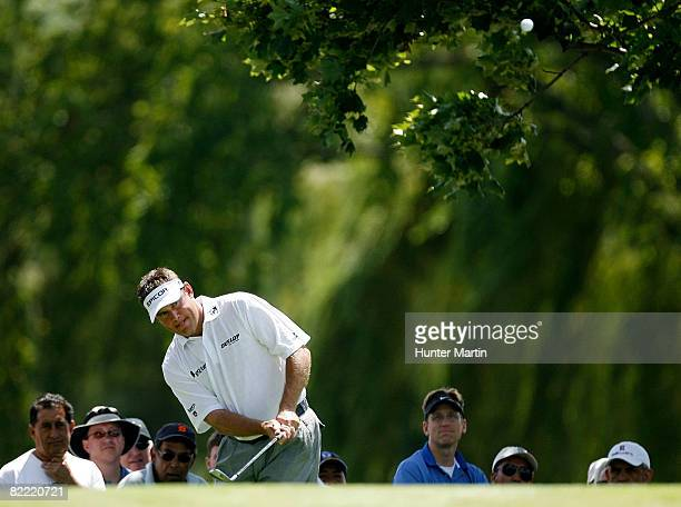 Lee Westwood of England plays his fourth shot on the second hole during round two of the 90th PGA Championship at Oakland Hills Country Club on...