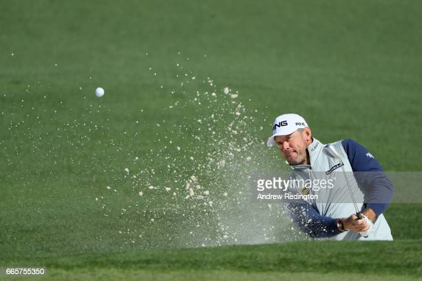 Lee Westwood of England plays his second shot from a bunker on the second hole during the second round of the 2017 Masters Tournament at Augusta...