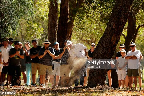 Lee Westwood of England plays his second shot from the rough on the 14th hole during day three of the World Super 6 at Lake Karrinyup Country Club on...