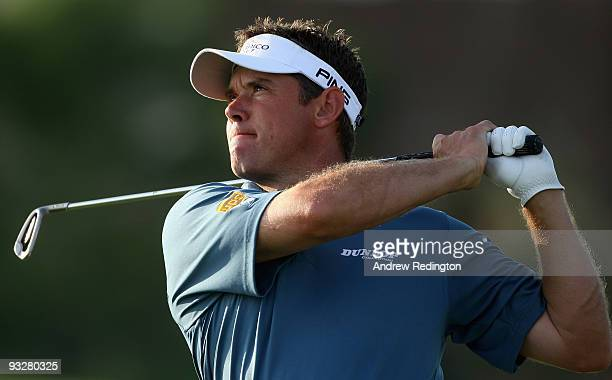 Lee Westwood of England plays his second shot on the 16th hole during the third round of the Dubai World Championship on the Earth Course Jumeirah...