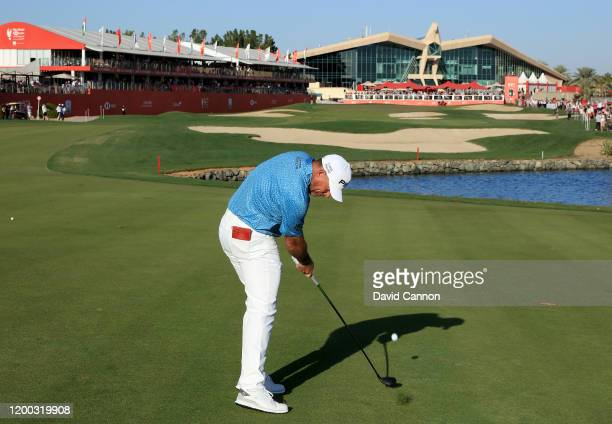 Lee Westwood of England plays his second shot on the 18th hole during the third round of the Abu Dhabi HSBC Championship at Abu Dhabi Golf Club on...