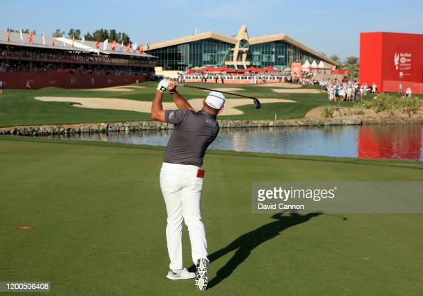Lee Westwood of England plays his second shot on the 18th hole during the final round of the Abu Dhabi HSBC Championship at Abu Dhabi Golf Club on...