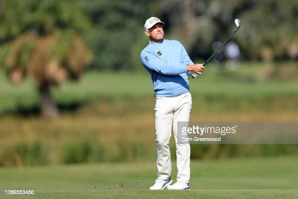 Lee Westwood of England plays his second shot on the eighth hole during the first round of The RSM Classic at the Seaside Course at Sea Island Golf...