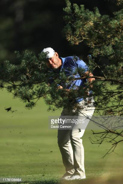 Lee Westwood of England plays his second shot on the ninth hole during the first round of the BMW PGA Championship at the Wentworth Club on September...