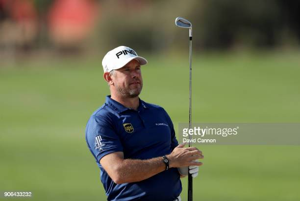 Lee Westwood of England plays his second shot on the par 4 14th hole during the first round of the 2018 Abu Dhabi HSBC Golf Championship at the Abu...