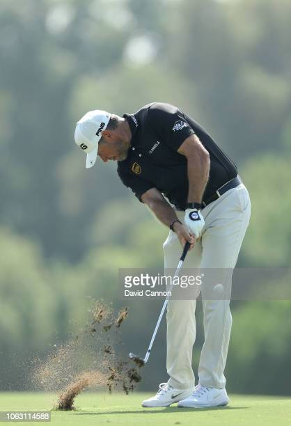 Lee Westwood of England plays his second shot on the par 4 third hole during the final round of the DP World Tour Championship on the Earth Course at...