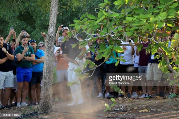 Lee Westwood of England plays his second shot on the par 5,18th hole during the final round of the DP World Tour Championship on the Earth Course at...