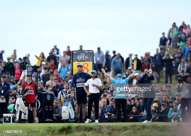 Lee Westwood of England plays his tee shot on the 18th hole watched by his playing partner Tommy Fleetwood of England during the third round of the...