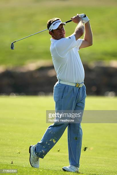 Lee Westwood of England plays into the 18th green during the first round of the Portugal Masters at Ocenico Victoria Clube de Golfe on October 18...
