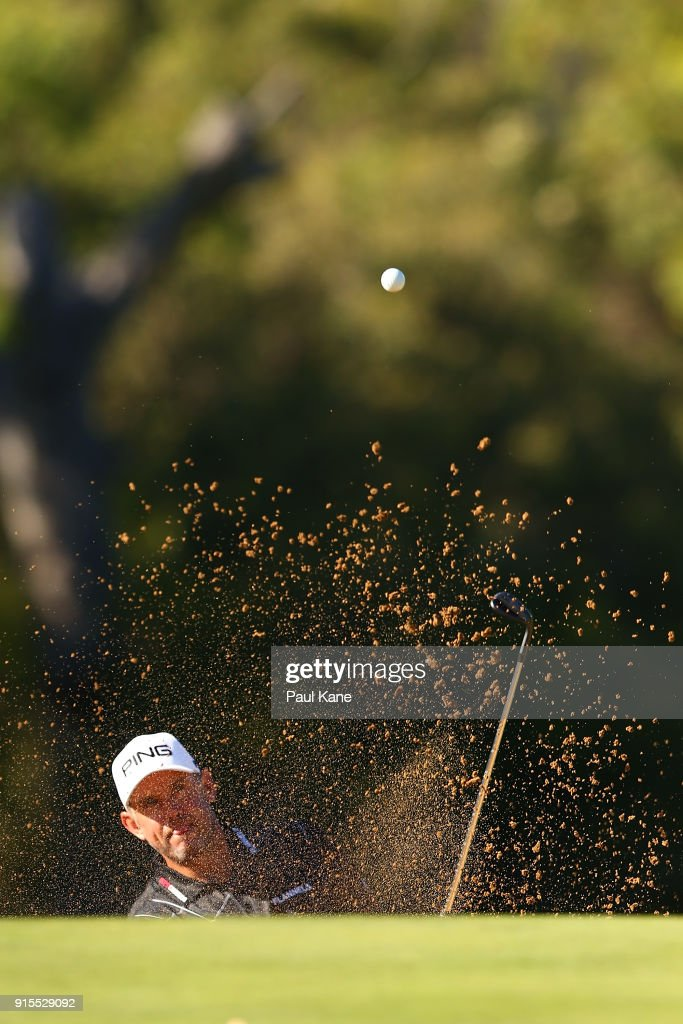 Lee Westwood of England plays out of a green side bunker on the 11th hole during day one of the World Super 6 at Lake Karrinyup Country Club on February 8, 2018 in Perth, Australia.