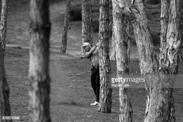 Lee Westwood of England plays out of the trees on the 15th hole during the third round of the Turkish Airlines Open at the Regnum Carya Golf Spa...