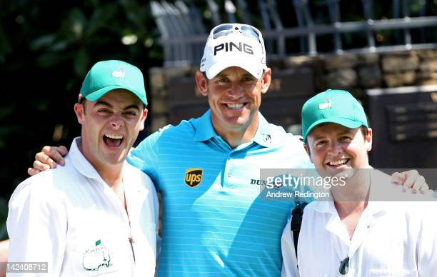 Lee Westwood of England poses with his caddies Anthony McPartlin and Declan Donnelly of the duo Ant and Dec during the Par 3 Contest prior the 2012...