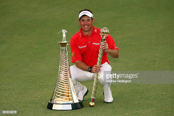 Lee Westwood of England poses with the trophy after winning the Dubai World Championship and the Race To Dubai on the Earth Course, Jumeirah Golf...