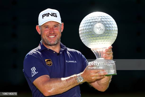 Lee Westwood of England poses with the trophy after winning the Nedbank Golf Challenge at Gary Player CC on November 11 2018 in Sun City South Africa